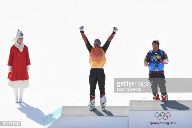 Canada's Brady Leman and Switzerland's Marc Bischofberger celebrate during the victory ceremony after placing first and second in the men's ski cross...