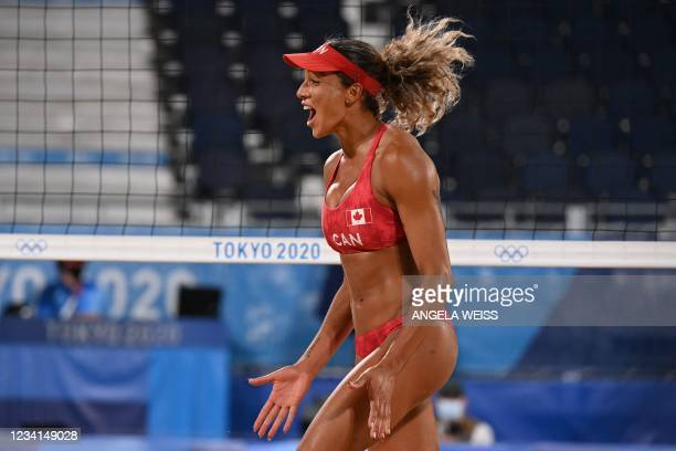 Canada's Brandie Wilkerson reacts in their women's preliminary beach volleyball pool C match between Canada and China during the Tokyo 2020 Olympic...