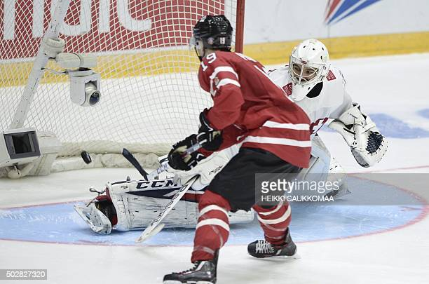 Canada's Brayden Point scores the first goal of the penalty shootout in front of the goal of Swiss goalie Joren von Pottelberghe during the 2016 IIHF...