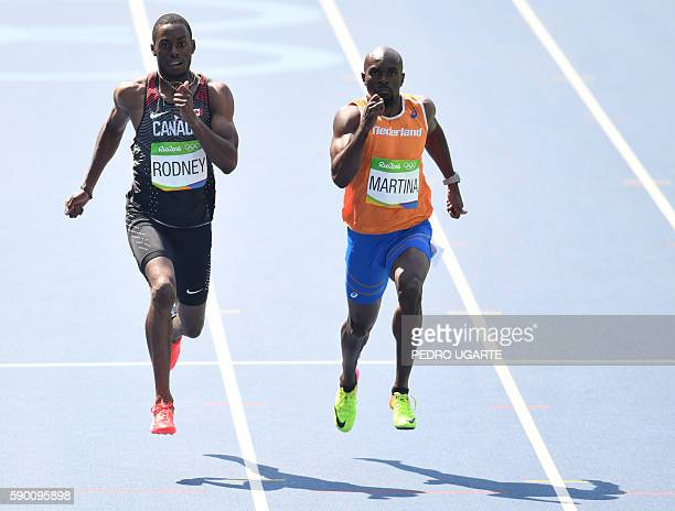 Canada's Brendon Rodney and Netherlands' Churandy Martina compete in the Men's 200m Round 1 during the athletics event at the Rio 2016 Olympic Games...