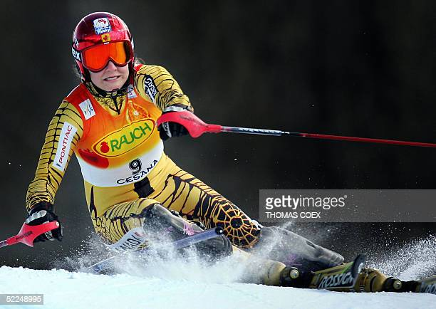 Canada's Brigitte Acton clears a gate during the women's ski World Cup combined slalom race in San Sicario 27 February 2005 Croatia's Janica Kostelic...