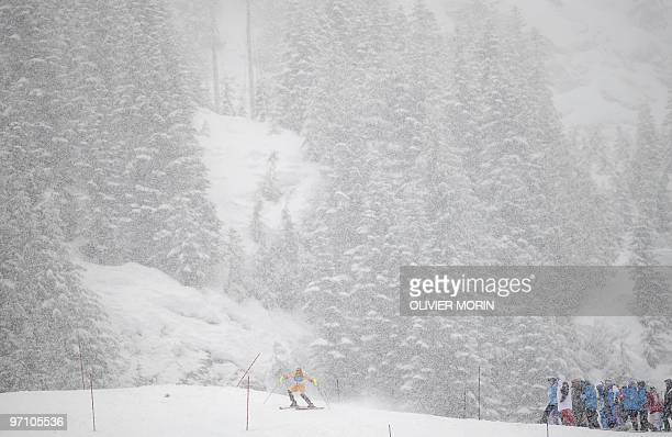 Canada's Brigitte Acton skis under heavy snowfall during the women's slalom race of the Vancouver 2010 Winter Olympics at the Whistler Creek side...