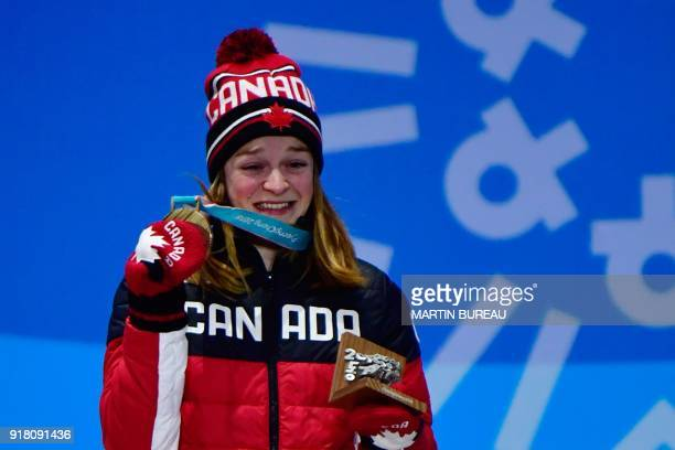 Canada's bronze medallist Kim Boutin cries of joy as she poses on the podium during the medal ceremony for the women's 500m short track at the...