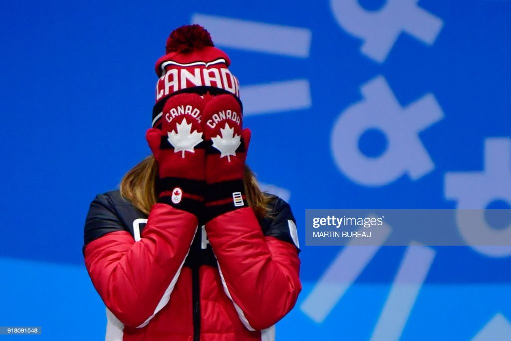 TOPSHOT - Canada's bronze medallist Kim Boutin cries of joy as she poses on the podium during the medal ceremony for the women's 500m short track at the Pyeongchang Medals Plaza during the Pyeongchang 2018 Winter Olympic Games in Pyeongchang on February 14, 2018. / AFP PHOTO / Martin BUREAU