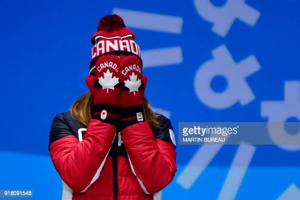 TOPSHOT Canada's bronze medallist Kim Boutin cries of joy as she poses on the podium during the medal ceremony for the women's 500m short track at...