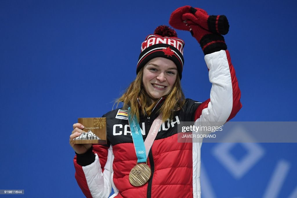 Canada's bronze medallist Kim Boutin poses on the podium during the medal ceremony for the short track women's 1500m at the Pyeongchang Medals Plaza during the Pyeongchang 2018 Winter Olympic Games in Pyeongchang on February 18, 2018. /