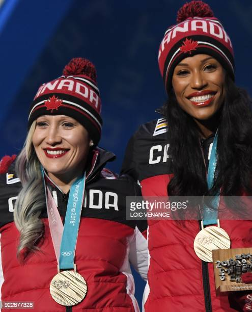 Canada's bronze medallists Kaillie Humphries and Phylicia George pose on the podium during the medal ceremony for the women's bobsleigh at the...