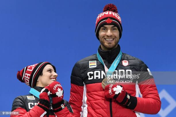 Canada's bronze medallists Meagan Duhamel and Eric Radford pose on the podium during the medal ceremony for the figure skating pair event at the...