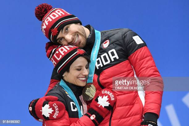 TOPSHOT Canada's bronze medallists Meagan Duhamel and Eric Radford pose on the podium during the medal ceremony for the figure skating pair event at...