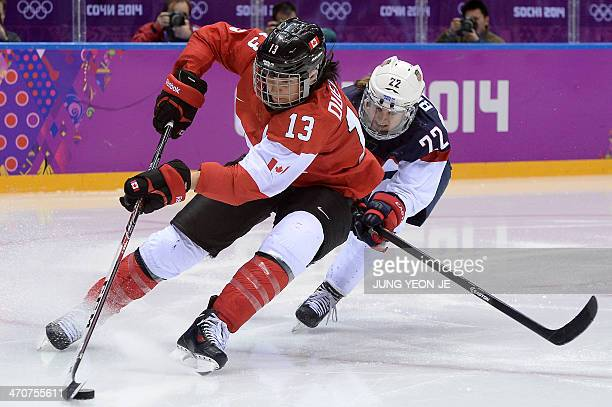 Canada's Caroline Ouellette vies with US Kacey Bellamy during the Women's Ice Hockey Gold Medal Game between Canada and USA at the Bolshoy Ice Dome...