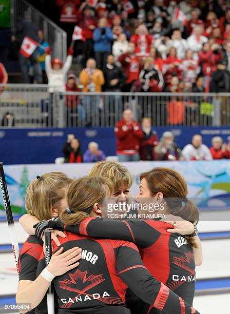 Canada's Carolyn Darbyshire celebrates their victory with her teammate Cori Bartel Susan O'Connor and Cheryl Bernard after the women's curling...