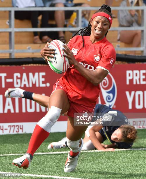 Canadas Charity Williams evades USAs Lauren Doyle to score a try during HSBC World Rugby Womens Sevens action in Langford BC Canada May 12 2019
