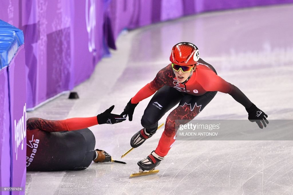 TOPSHOT - Canada's Charle Cournoyer competes in the men's 5,000m relay short track speed skating heat event during the Pyeongchang 2018 Winter Olympic Games, at the Gangneung Ice Arena in Gangneung on February 13, 2018. / AFP PHOTO / Mladen ANTONOV