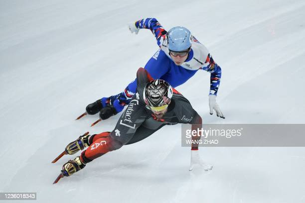 Canada's Charles Hamelin competes in the men's 1500m quarter finals during the 2021/2022 ISU World Cup short track speed skating, part of a 2022...
