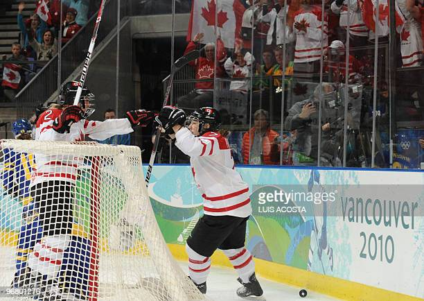 Canada's Cherie Piper celebrates a goal in the first period during the Women's Ice Hockey preliminary game between Canada and Sweden at the UBC...