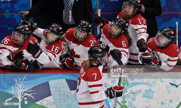 Canada's Cherie Piper celebrates with teammates after scoring in the first period of Canada's semi final game against Finland at Canada Hockey Place...