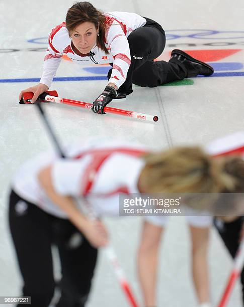 Canada's Cheryl Bernard checks the direction during their Vancouver Winter Olympics women's curling round robin match against Sweden at the Vancouver...
