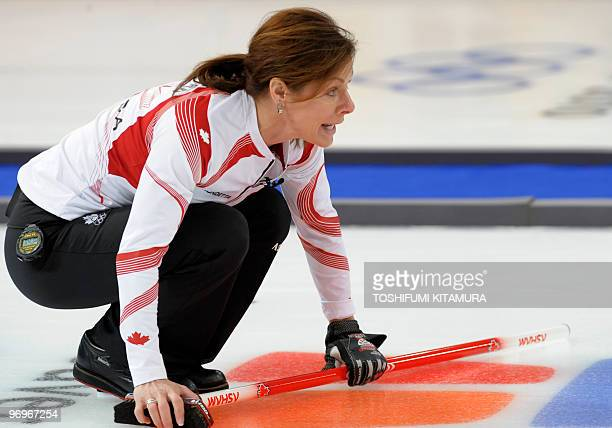Canada's Cheryl Bernard instructs the direction during their Vancouver Winter Olympics women's curling round robin match against Sweden at the...