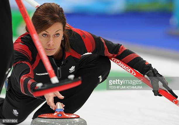 Canada's Cheryl Bernard releases the stone during the Vancouver Winter Olympics women's curling semifinal match against Switzerland at the Vancouver...