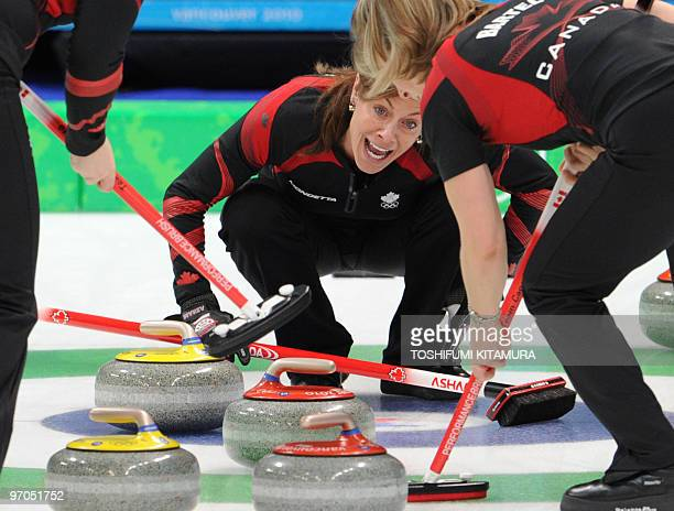 Canada's Cheryl Bernard shouts the direction during the Vancouver Winter Olympics women's curling semifinal match against Switzerland at the...