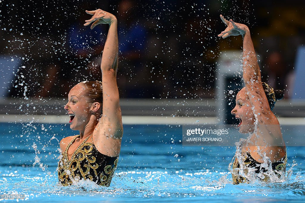 Canada's Chloe Isaac and Karine Thomas compete in the duet technique preliminary round during the synchronised swimming competition in the FINA World Championships at the Palau Sant Jordi in Barcelona, on July 21, 2013.
