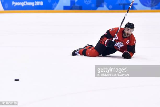 Canada's Chris Lee lies on the ice in the men's preliminary round ice hockey match between Canada and South Korea during the Pyeongchang 2018 Winter...