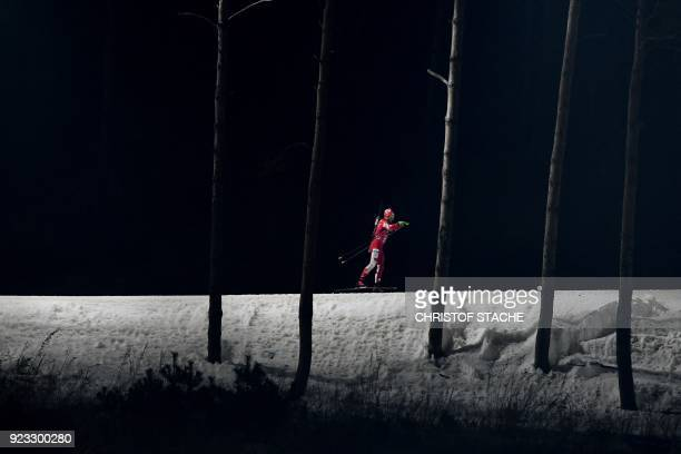 TOPSHOT Canada's Christian Gow warms up prior to the men's 4x75km biathlon event during the Pyeongchang 2018 Winter Olympic Games on February 23 in...