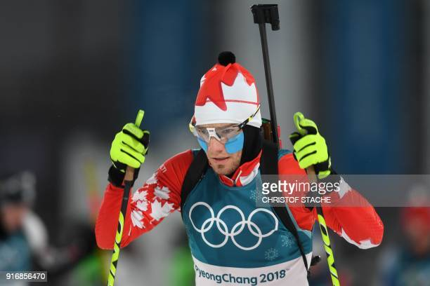 Canada's Christian Gow wears cheek warmers prior to the start of the men's 10km sprint biathlon event during the Pyeongchang 2018 Winter Olympic...