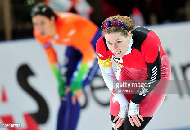 Canada's Christine Nesbitt catches her breath next to Netherland's Margot Boer after competing in the women's 1000m race of the ISU Speedskating...