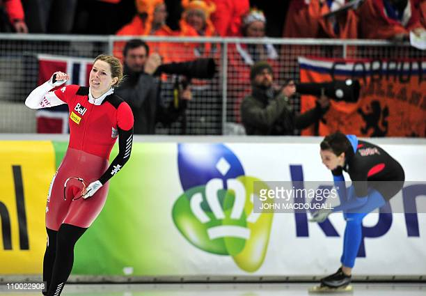 Canada's Christine Nesbitt celebrates her races to victory as Heather Richardson of the US places third place in the women's 1000m competition of the...