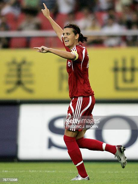 Canada's Christine Sinclair celebrates her opening goal against Ghana in Hangzhou, 15 September 2007 in eastern China's Zhejiang province, during a...