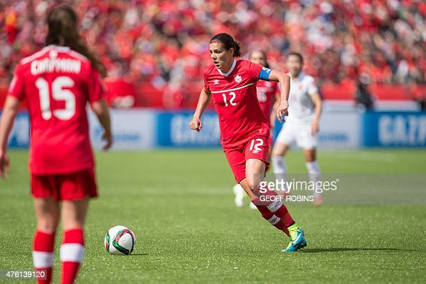 Canada's Christine Sinclair controls the ball during a Group A football match between Canada and China at Commonwealth Stadium during the opening...