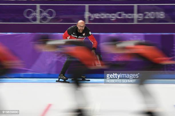 Canada's coach encourages his team compete in the men's team pursuit quarterfinal speed skating event during the Pyeongchang 2018 Winter Olympic...