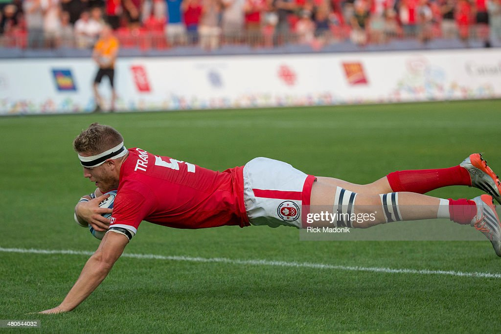 TORONTO, - JULY 12, 2015 - Canada's Conor Trainor scores one of his two try's. Men's Gold medal match between Canada and Argentia of Rugby 7s, at Exhibition Stadium. Toronto 2015 Pan Am coverage. Photographed on JULY 12, 2015. Canada won 22-19.