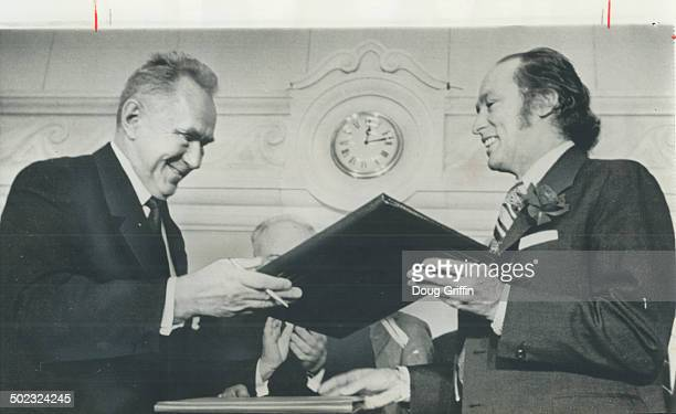 Canada's copy of an agreement under which the Soviet Union and Canada will exchange scientists academics students artists and sportsmen is handed to...