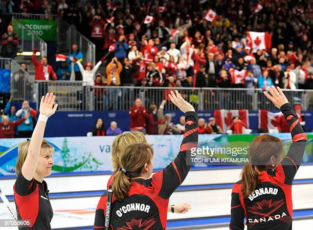 Canada's Cori Bartel Carolyn Darbyshire Susan O'Connor and Cheryl Bernard wave to supporters after winning the women's curling semifinal match...