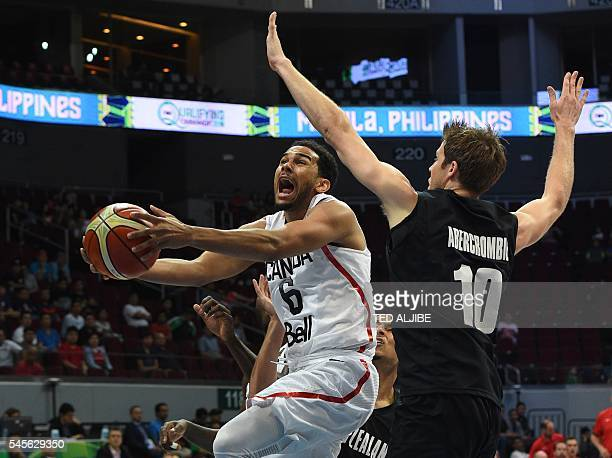 Canada's Cory Joseph drives past Thomas Abercrombie of New Zealand during their game at the 2016 FIBA Olympic men's qualifying basketball tournament...