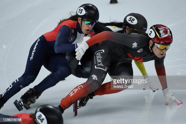 Canada's Courtney Sarault competes in the women's 1500m quarter-finals during the 2021/2022 ISU World Cup short track speed skating, part of a 2022...