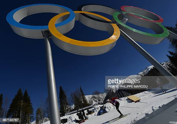 Canada's cross country athlete Jesse Cockney skis by the Olympic Rings during a training session at the Laura Cross Country Skiing and Biathlon...