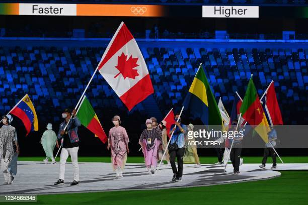 Canada's Damian Warner carries his national flag during the closing ceremony of the Tokyo 2020 Olympic Games, at the Olympic Stadium, in Tokyo, on...