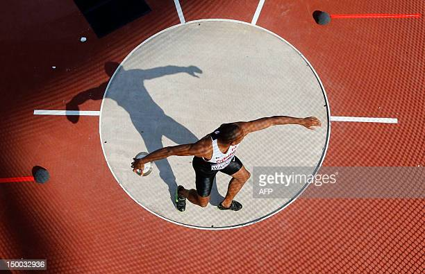 Canada's Damian Warner competes in the men's decathlon discus throw at the athletics event during the London 2012 Olympic Games on August 9 2012 in...