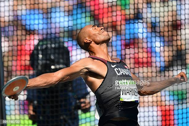TOPSHOT Canada's Damian Warner competes in the Men's Decathlon Discus Throw during the athletics event at the Rio 2016 Olympic Games at the Olympic...