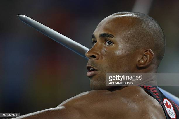 Canada's Damian Warner competes in the Men's Decathlon Javelin Throw during the athletics event at the Rio 2016 Olympic Games at the Olympic Stadium...