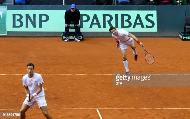 Canada's Daniel Nestor and Vasek Pospis return the ball to Croatia's Marin Cilic and Ivan Dodig during the first round Davis Cup World Group doubles...