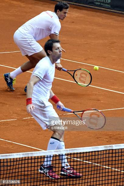 Canada's Daniel Nestor and Vasek Pospis return the ball to Croatia's Marin Cilic and Ivan Dodig during the Davis Cup World Group fiorst round double...