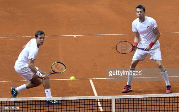 Canada's Daniel Nestor and Vasek Pospisil return the ball to Croatia's Marin Cilic and Ivan Dodig during the double match as part of the Davis Cup...