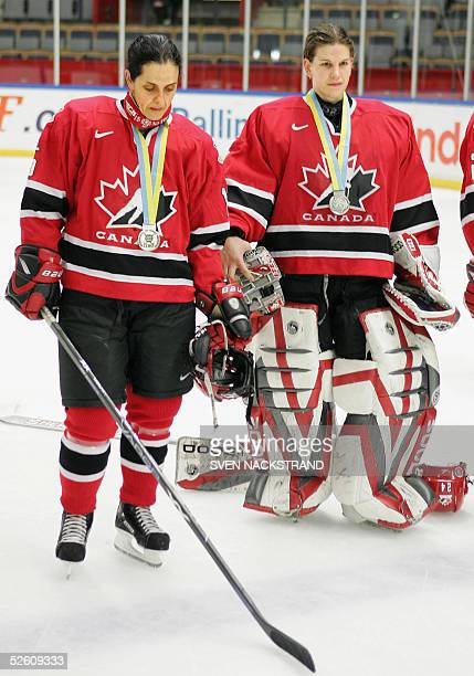 Canada's Danielle Goyette and goalkeeper Kim St Pierre pose after the loss to USA in the IIHF Womens World Championship final played in Linkoeping...