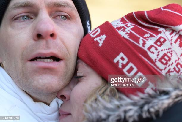 Canada's Dave Greszczyszyn reacts after missing the chance to qualify for the next round after the mens's skeleton heat 3 run during the Pyeongchang...