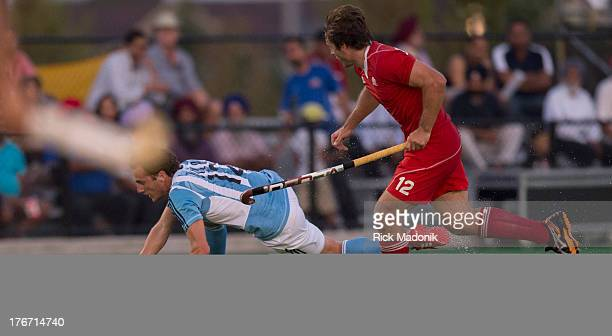 BRAMPTON ON AUGUST 17 Canada's David Jameson tries to chase down a falling Lucas Vila Mens Pan American Cup final between Canada and Argentina in...
