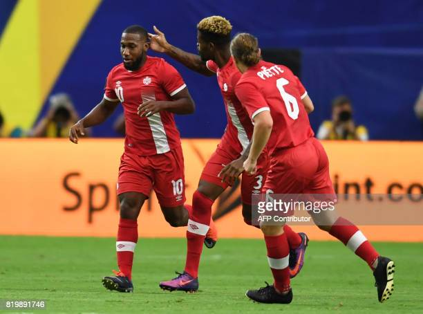 Canada's David Junior Hoilett celebrates with teammates after scoring a goal during the 2017 CONCACAF Gold Cup at the University of Phoenix Stadium...